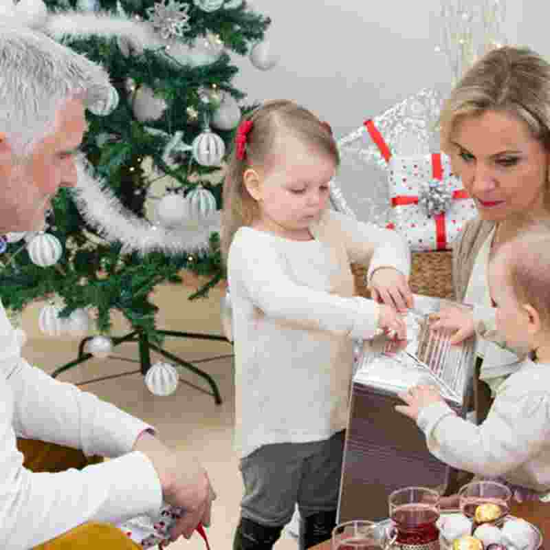 christmas-children-opening-presents-squ.jpg